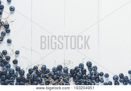 Blueberries on vintage wooden white background top view healthy food on dark table mockup berry for smoothie isolated on rustic vintage country board fresh bilberry nutrition mock up closeup copy space for text design
