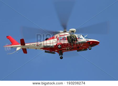 Veneto, Italy - May 26, 2016: Helicopter Of Italian Fire Brigade With A Fireman Leaving The Door