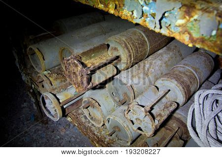 Rusted tank shells on an abandoned military depot