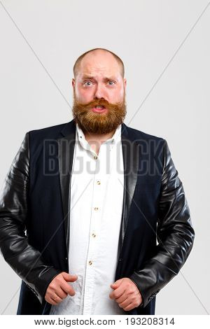 Frowning man with ginger beard