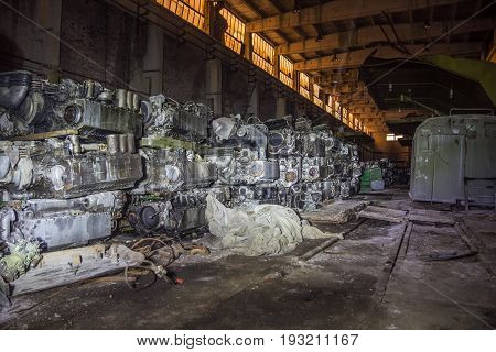 Military warehouse with rusted tank diesel engines, Kharkov tank factory, Ukraine