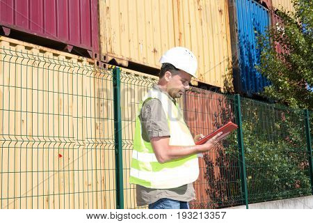 Engineer Use Tablet Order Working On A Container Yard