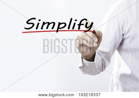Businessman hand writing Simplify with marker Business concept