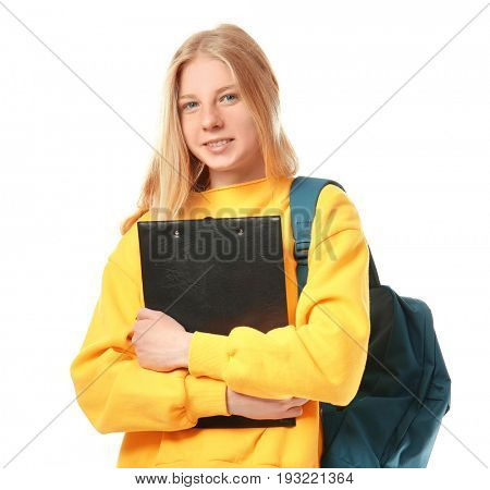 Cute teenager girl with schoolbag and clipboard on white background