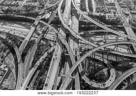 Aerial of the Harbor 110 and Century 105 freeway interchange south of downtown Los Angeles in black and white.