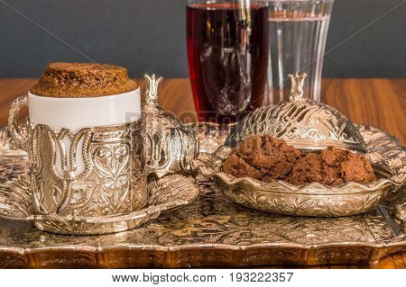 Turkish Coffee Served With Water, Sherbet And Cookies In Traditional Copper Serving Set