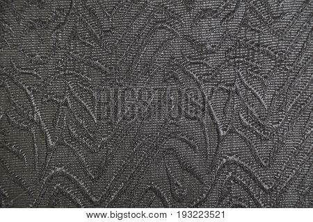 Knitwear fabric with gray abstract volume pattern. Part of a dress