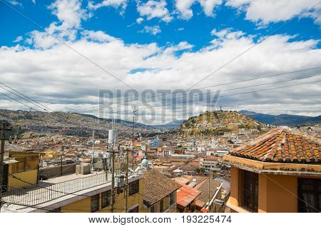Top view of the colonial town with some colonial houses located in the city of Quito.