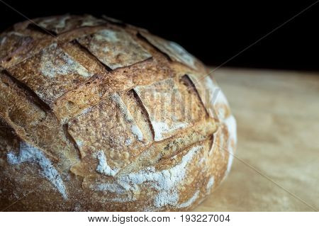 Close-up of crusty garlic bread on wooden background