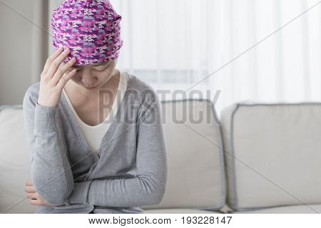 poor cancer woman feels bad at home