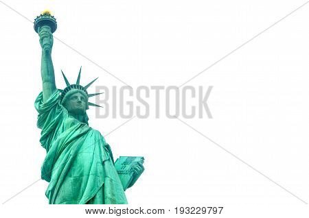 Statue of Liberty on Liberty Island in New York Harbor in New York City in the United States - isolated on white