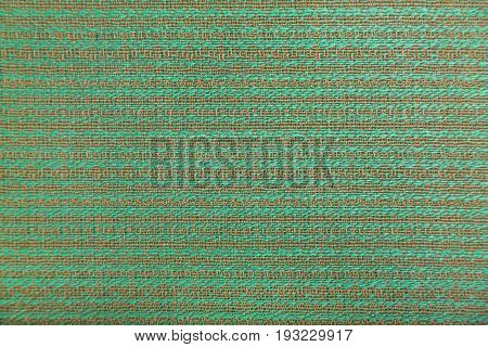 Wool fabric with bright green and brown geometric minimalistic pattern in the form of lines.