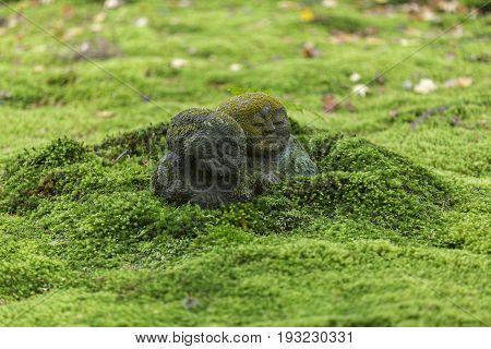 KYOTO JAPAN - 19 NOVEMBER 2015: Stone statues in the moss garden at Sanzenin Temple in Kyoto Japan