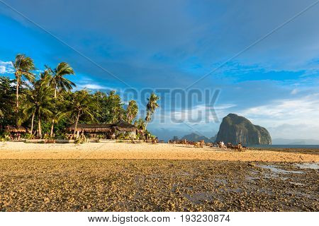 EL NIDO, PALAWAN, PHILIPPINES - MARCH 29, 2017: Horizontal picture of a beachfront restaurant at Cabanas Beach.