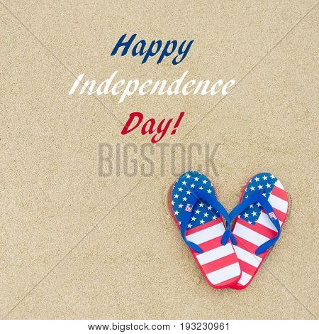 Independence USA background with flip flops on the sandy beach near ocean square format