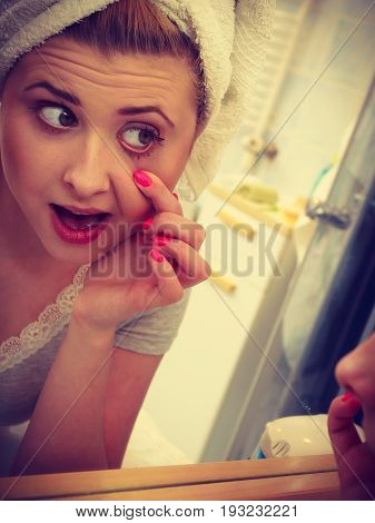 Woman Looking At Her Reflection In Mirror