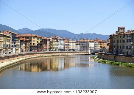 Pisa, Italy - June, 5, 2017: embankment of Arno river in Pisa, Italy