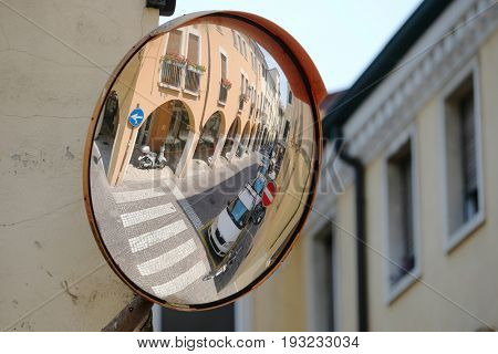 PADOVA, ITALY - June, 22, 2017: veiw from a street mirror to a street in a center of Padova, Italy