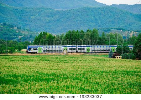 Rovigo, Italy - June, 14, 2017: train drives cross the filds near Monselice, Italy