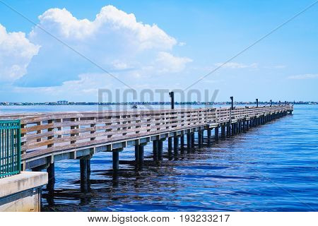 A fishing pier jutting out into Charlotte Harbor in southwest Florida to be enjoyed by all.
