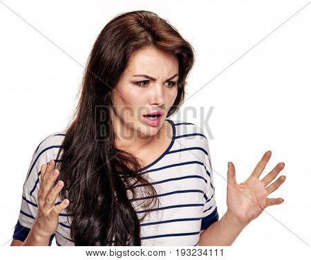 Portrait of frustrated angry young woman gesturing with hands