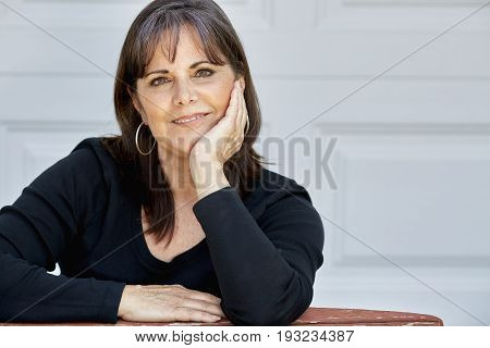 Middle Aged Woman Smiling With Hands On Cheeks