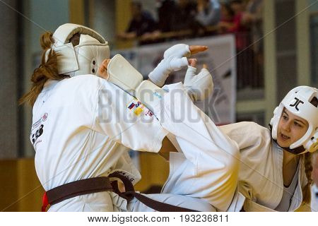 BERLIN - MARCH 18 2017: Girls-fighters on the tatami. European championship Kyokushin World Union (KWU) for Children and Youth.