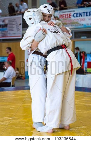 BERLIN - MARCH 18 2017: Fighters on the tatami. Hugs after the battle. European championship Kyokushin World Union (KWU) for Children and Youth.