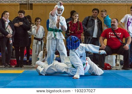 BERLIN - MARCH 18 2017: Fighters on the tatami. Knockdown. European championship Kyokushin World Union (KWU) for Children and Youth.