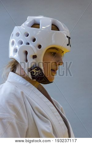 BERLIN - MARCH 18 2017: Girl-fighter in a protective helmet close-up. European championship Kyokushin World Union (KWU) for Children and Youth.