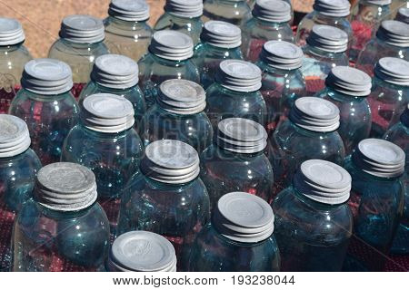 repetition of antique blue glass jar lids