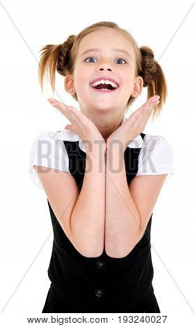 Surprised happy school girl child in uniform isolated on a white background education concept