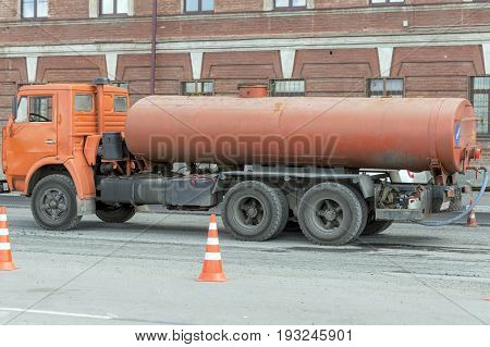 NIZHNY NOVGOROD, RUSSIA June 28, 2017 : Auto appliances communal services of the city. KAMAZ trucks with a capacity for water purification and cleaning of curbs, bumpers,  the city.  NIZHNY NOVGOROD