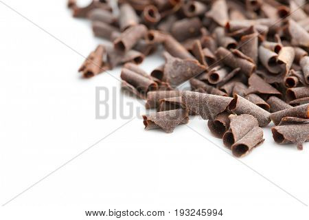 Tasty chocolate curls isolated on white background.