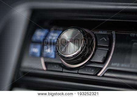 Car audio volume control, button, unit, front, panel closeup.