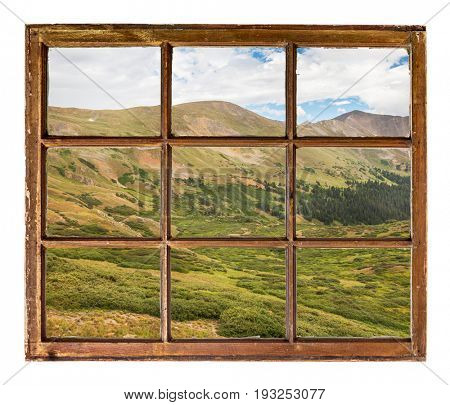 alpine meadows in Rocky Mountains, Colorado, as seen  through vintage, grunge, sash window with dirty glass