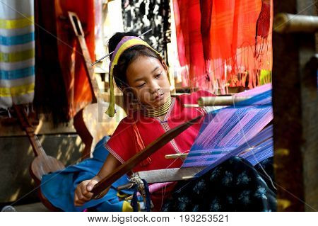 MAEHONGSON THAILAND- APR 6: Unidentified longneck karen young girl making textile goods at the place for tourism on Apr 62015 in MaehongsonThailand