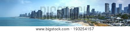 Tel Aviv skyline by day with beach sea and waves poster