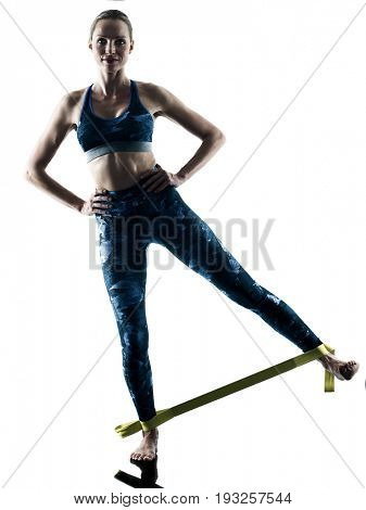 one caucasian woman exercising fitness elastic excercises in silhouette isolated on white background