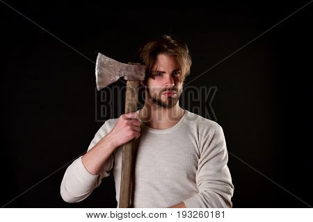 Bearded Brutal Guy With Casual Hairstyle Holds Old Sharp Axe