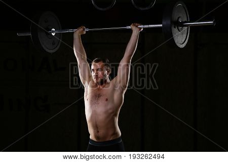 Sportsman Holding Barbell Above His Head