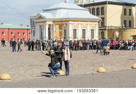 St. Petersburg Russia - 28 May, Selfi tourists on Cathedral Square, 28 May, 2017. Famous sightseeing places of St. Petersburg for tourists.
