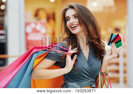 Attractive Girl In Shopping Mall With Bags