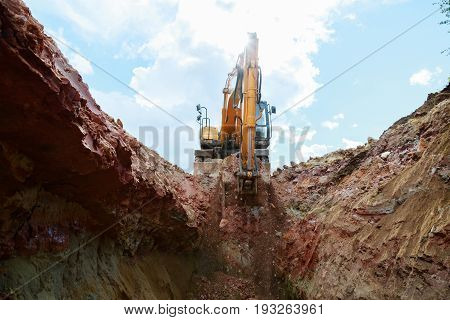 Excavator Digging A Pit. Bucket Lifts The Ground.