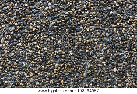 The texture of the wall in the form of conglomerate