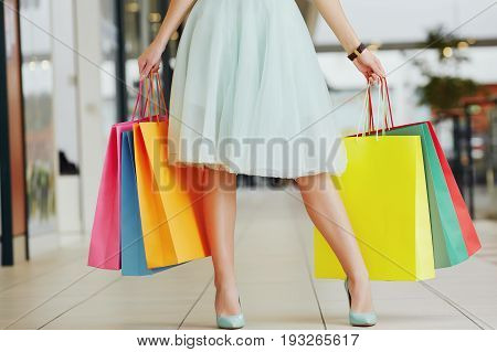 Pretty Girl's Legs With Shopping Bags