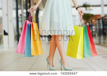 Girl In Shopping Mall With Bags