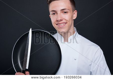 Closeup Portrait Of Handsome Chef With Kitchen Ustensils