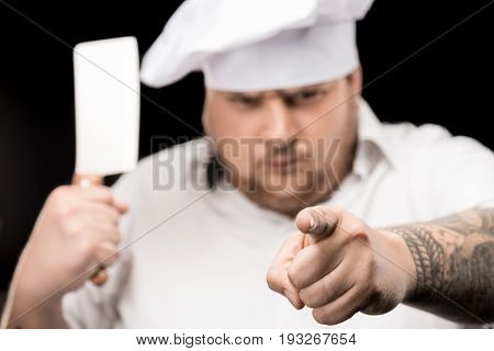 Close-up View Of Professional Chef Holding Meat Knife And Pointing At Camera