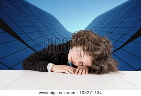 Cute Kinky Businessman Sleeping On The Table Against The Background Of A Glass Building. Close-up.